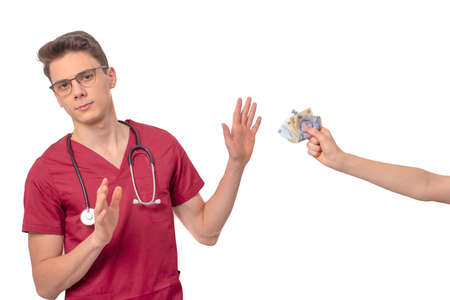 Young doctor refusing bribe in exchange for his services 版權商用圖片