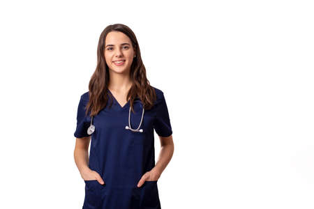 cheerful young female doctor with stethoscope over neck looking at camera isolated on white Stock fotó