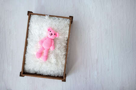 Top view of a plush toy representing the expectation of a child