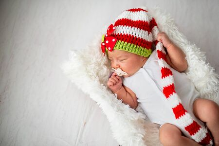 newborn baby in studio with pacifier