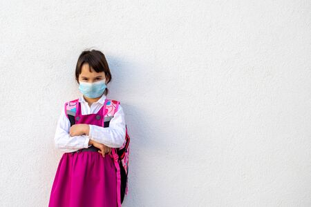 Little angry school girl waiting for school to reopen after pandemic outbreak