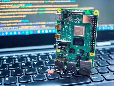 Galati, ROMANIA - March 22, 2020: Close-up of a Raspberry Pi 4 Model-B on a laptop keyboard. The Raspberry Pi is a credit-card-sized single-board computer developed in the UK Sajtókép