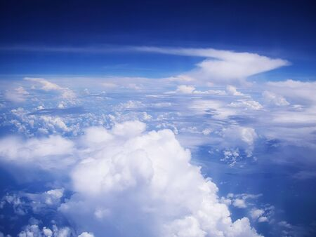 puffy: View on cloudscape and blue sky from above