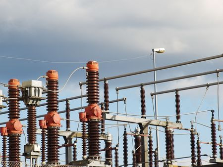 isolator insulator: High voltage electric power transformer substation. Industrial ceramic insulators.