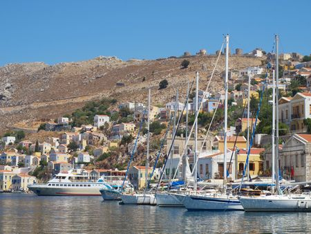 Moorage of Symi town with moored motor boats and yachts, Greece. photo