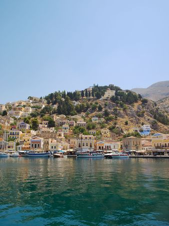 Symi town waterfront with moored motor boats and yachts, Greece. photo