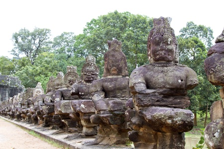 Angkor Thom (ancient royal city) entrance bridge with row of demon figures. Siem Reap, Cambodia. photo