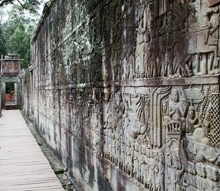 Bayon  Temple stone wall carving. Angkor, Siem Reap, Cambodia. photo