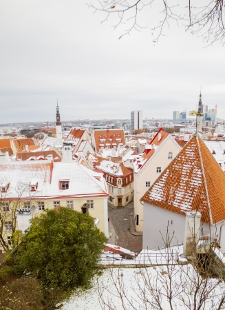 Tallinn old town clay tiles roofs at winter. photo