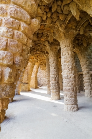 Famous stone colonnade in Parc Guell, Barcelona, Spain  Stock Photo - 21392599
