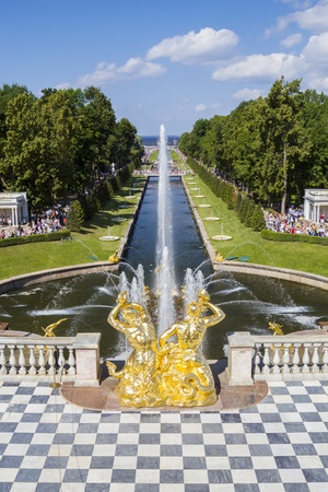 SAINT_PETERSBURG, RUSSIA - JULY 27  Peterhof palace park main channel with fountains on July 27, 2013 in Saint-Petersburg, Russia  Peterhof Palace park is one of the most remarkable in Europe laid out on the order of Peter The Great
