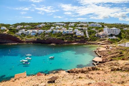 Cala Morell cove scenery in sunny day at Menorca, Spain  photo