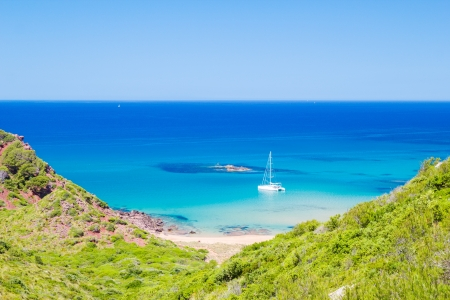 Cala del Pilar beach scenery in sunny day at Menorca, Spain  photo