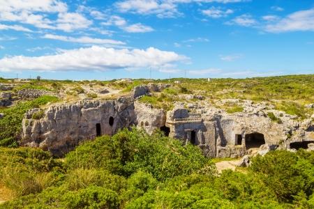 menorca: Cala Morell Necropolis Caves in sunny day at Menorca, Spain