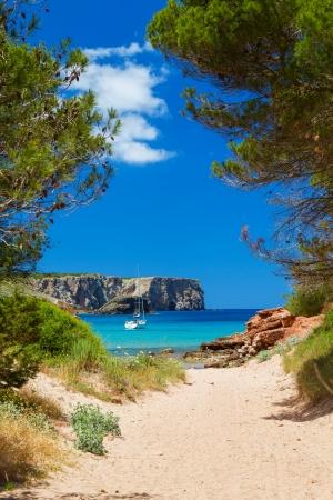 View on Cala Algaiarens from sand pathway to the beach, Menorca island, Spain