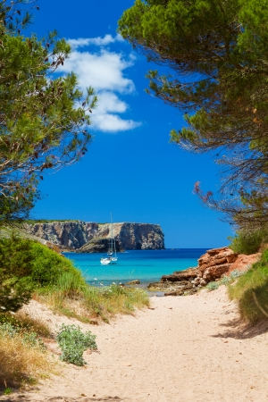 View on Cala Algaiarens from sand pathway to the beach, Menorca island, Spain