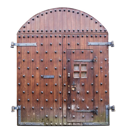Front view of old medieval wooden castle gates isolated on white background  photo