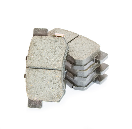 Automobile brake pads set isolated on white background  photo