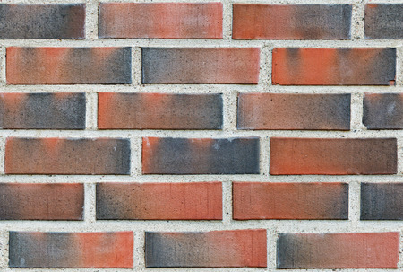 lining: Burned red lining brick wall seamless background