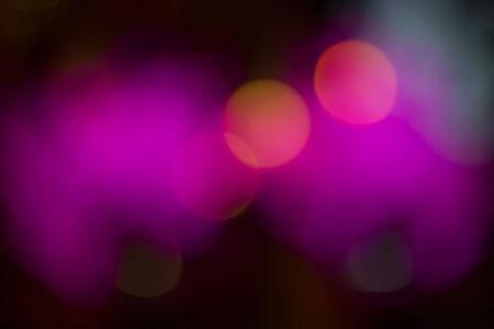 backgrund: Purple effect bokeh holiday night backgrund.