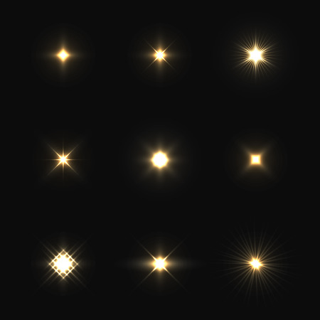 Set of vector lens flares isolated on black background. Vectores