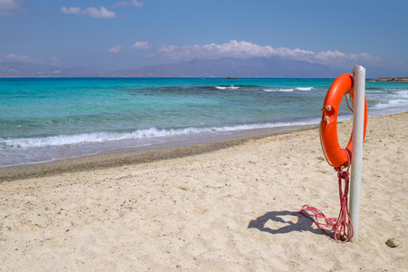 uninhabited: Chrisi Chrysi island white beach with red  life buoy in foreground, Crete, Greece. One of the most beautiful uninhabited island of Greece.