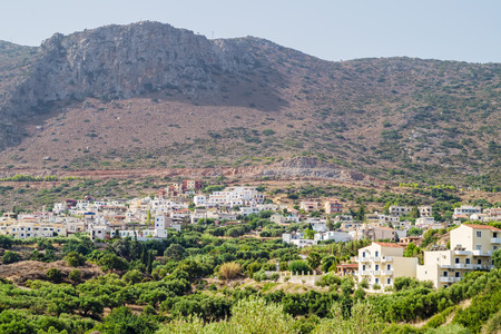 plumb: Piskopiano village in sunny summer day with the plumb cliff in the background, Crete, Grece.