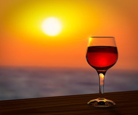 夏のサンセットのロマンチックな背景で赤ワインのガラス。
