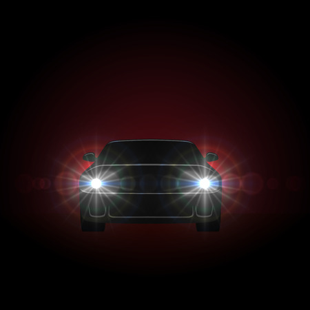 gloom: Bright car headlights shining from dark background with copy space.