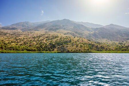 kournas: Kurna lake with mountain landscape in the background, Crete, Greece. Stock Photo