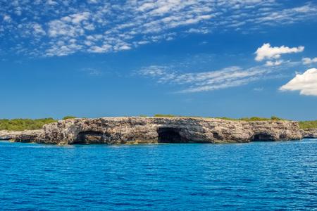 Menorca island south Mediterranean sea coast rock caves. Balearic islands, Spain. Stock Photo