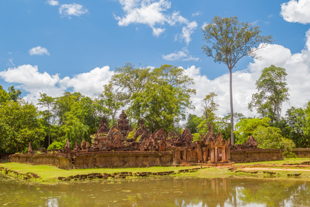Ancient ruins of small beautiful Banteay Srei Temple made of red sandstone, Siem Reap, Cambodia. It was dedicated to the Hindu god Shiva.
