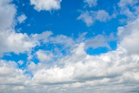 heaven light: Blue sky with white cumulus clouds background. Stock Photo