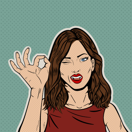 Vintage Pop Art Illustration with Brunette Woman's Face with OK Gesture of the Hand and Winking with the Eye. Comic Book Close-Up Girl Giving an OK. Retro Style Card. Approbation concept. Vector Illustration.