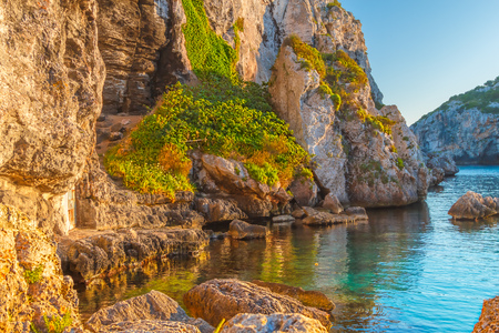 Mediterranean Sea Cliffs at Cales Coves at Sunset, Menorca Island, Spain. Stock Photo