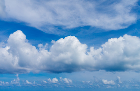 White Fluffy Clouds on Blue Sky Background. Summer Sky Backdrop. Imagens