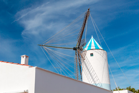 Traditional Old White Windmill against Blue Sky at Menorca Island, Spain. Imagens