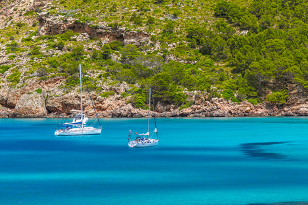 Cala Algaiarens Ð¡ove with Yachts Floating on Water at Menorca Island, Spain