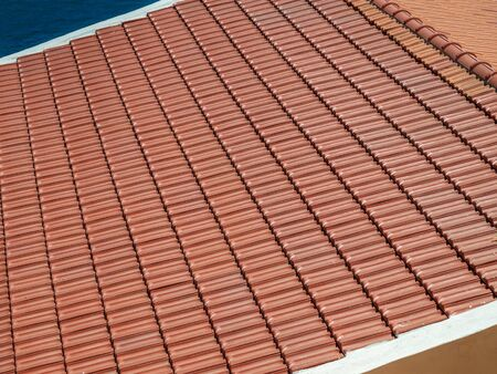 Red Clay Tile Roof. Ceramic Roofing Technology.