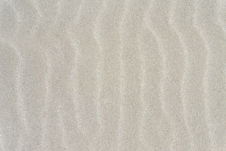 White Beach Sand Wavy Surface Background. Tropical Background.