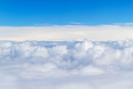 White Fluffy Clouds with Blue Sky Above. White Clouds from Airplane.