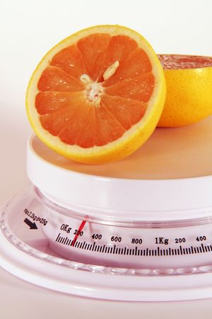 grapefruit on a scale Stock Photo