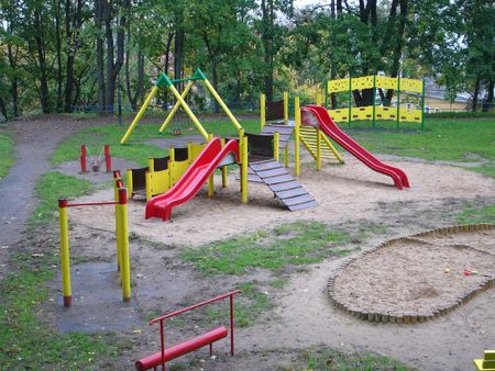 Playground with swing and slide in the park