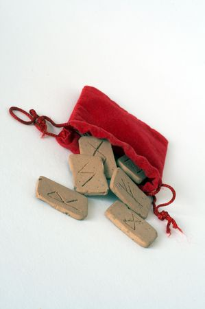 odin: clay runes falling out of red bag