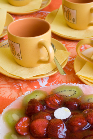 Cake with strawberries and kiwi slices and coffee cup Stock Photo - 1415526