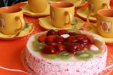 Cake with strawberries and kiwi slices and coffee cup Stock Photo - 1415519