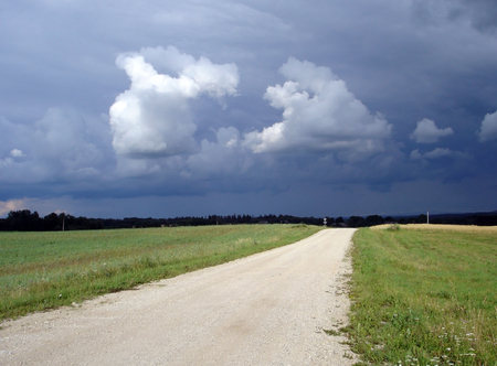 Landscape with cloudy sky and empty road Stock Photo - 1576822