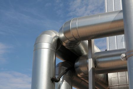 modern metallic ventilation ducts, blue sky background