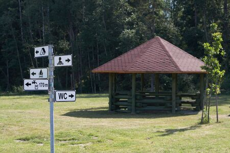 camping site: Camping site with directional sign for swimming and camping