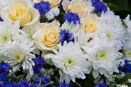Bouquet of white roses and blue cornflowers